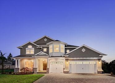 Beautiful-Exterior-of-New-Luxury-Home-at-Twilight-524085051_3510x2553.jpeg