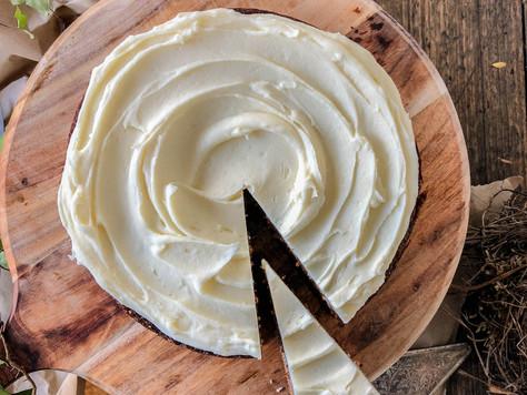 Persimmon, Hazelnut, Cardamom & Polenta Cake with a Honeyed Cream Cheese Icing.