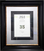 Premium certificate framing, black and gold frame with silver and black mountings.