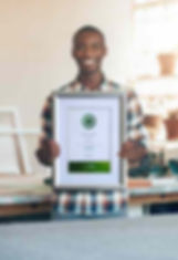 Artisan holding up a custom certificate frame.