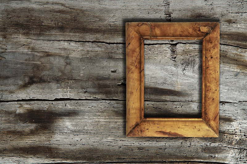Rustic pctur frame on wooden background