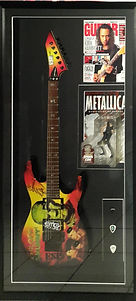 Box framed Metallica guitar with magazines and guitar picks. Black frame, black mount