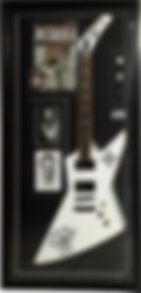 Box framed Metallica guitar with magazines, band photos and guitar picks. Black frame, black mount