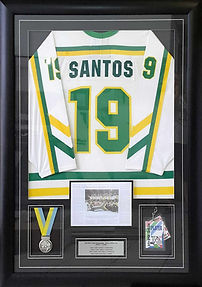 Box framed hockey shirt with medals and photos. Black frame