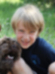 Young Boy with an Australian Labradoodle dog outoors in Colorado