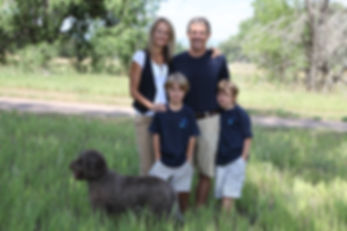 Family with an Australian Labradoodle dog outoors in Colorado