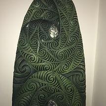 Aaron Kereopa carved surfboard