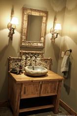 powder bath. rock sink. custom reclaimed wood vanity.