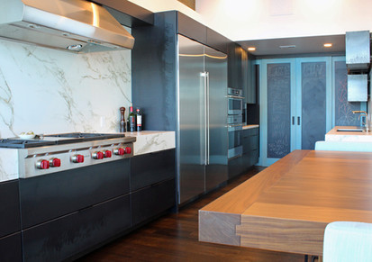 modern lake house. hot rolled steel custom cabinetry.