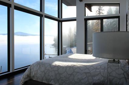 modern lake house. master bedroom