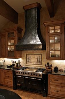 hammered steel custom range hood. design by molly scott | interior design