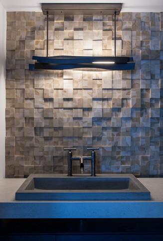 modern lake house. powder bath. custom wood wall treatment. concrete trough sink. industrial fittings
