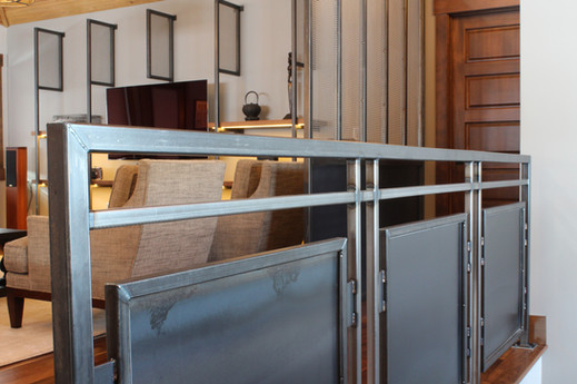 custom hot rolled steel railing, screen and wall shelving unit. designed by molly scott   interior design. crafted by carlson sheet metal