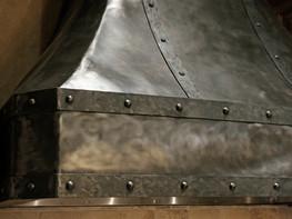 hammered steel custom range hood. Design by molly scott   interior design