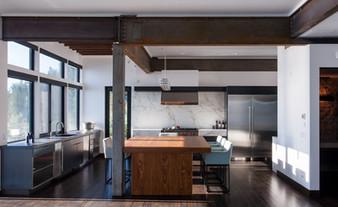 modern lake house. hot rolled steel custom cabinetry