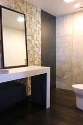 modern lake house powder bath. custom wood wall treatment. industrial fittings