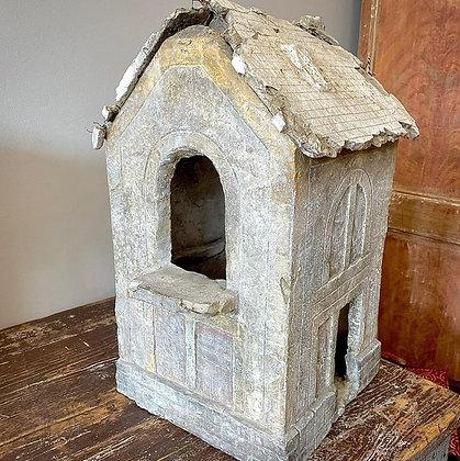 PLASTER MODEL OF A HOUSE IN DISREPAIR