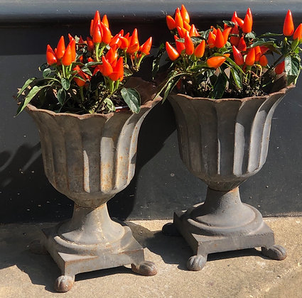 Fluted cast iron urns