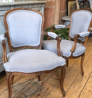 Newly upholstered pair of antique French armchairs