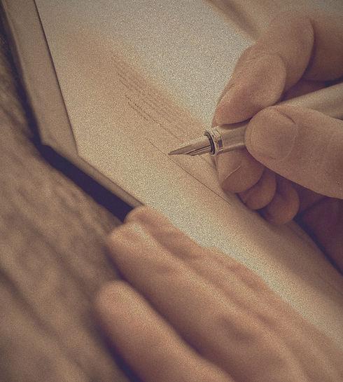 hands-putting-a-signature-PSKFQR7_edited_edited.jpg