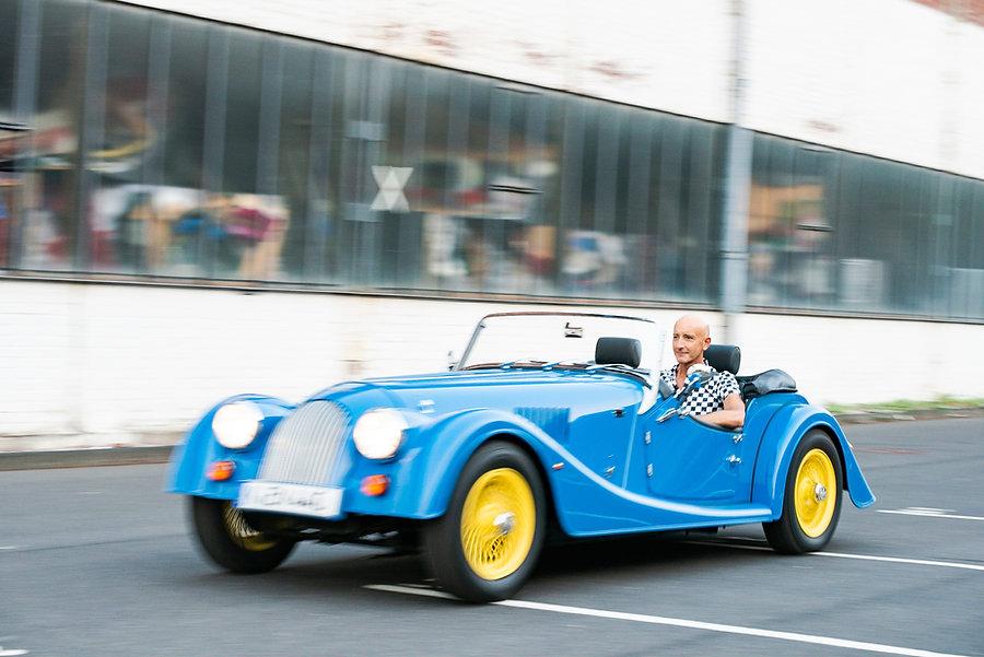 portrait professor paolo tumminelli, driving morgan 4/4