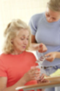 Home care nurse helping elderly lady to