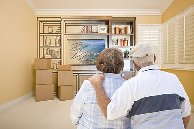Senior Couple In Room With Moving Boxes