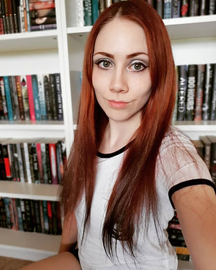 Author in front of bookshelf