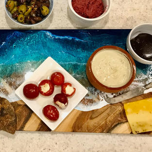 Impress your friends when entertaining by serving up your next nibbles on my unique resin art cheeseboards and serving ware.