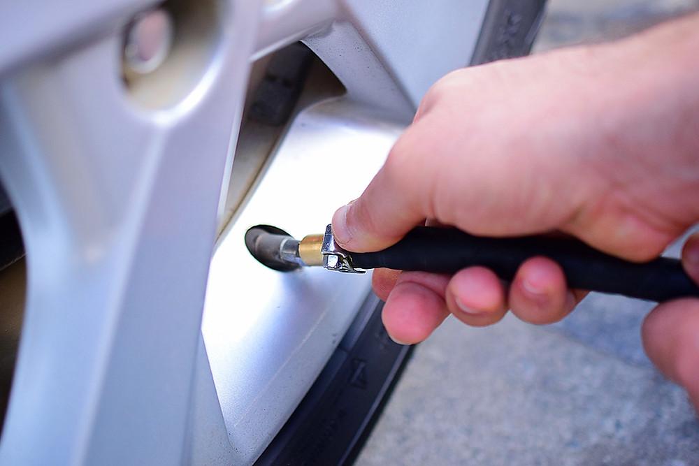 Person doing flat tire repair