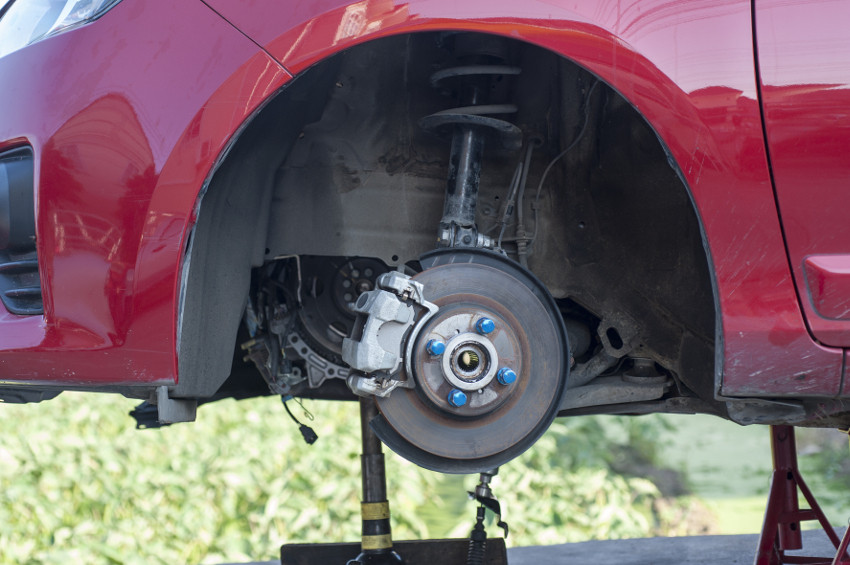 auto shop replacing car brakes