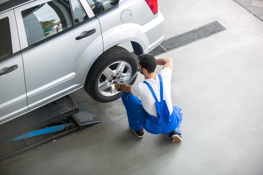 Auto shop worker does tire maintenance
