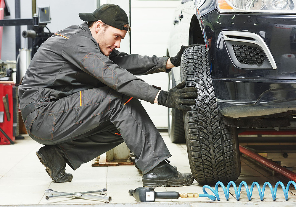 Auto Shop Mechanic Wheel Alignment