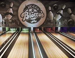 hooch and blottos logo over bowling lanes
