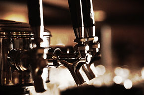 image of beer taps in sephia tone