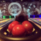 image of red bowling balls with bowling lanes in the background