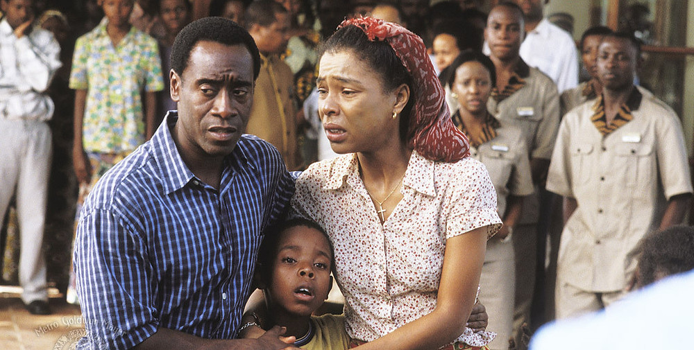 HOTEL RWANDA - Paul (Cheadle) and his wife, Tatiana (Sophie Okonedo) in front of the Hôtel des Mille Colline