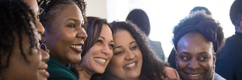 Kamala Harris smiling with four young women