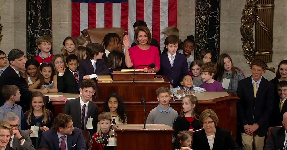 Congresswoman Nancy Pelosi posing with the children and grandchildren of members of Congress at the 2019 Congressional swearing in.