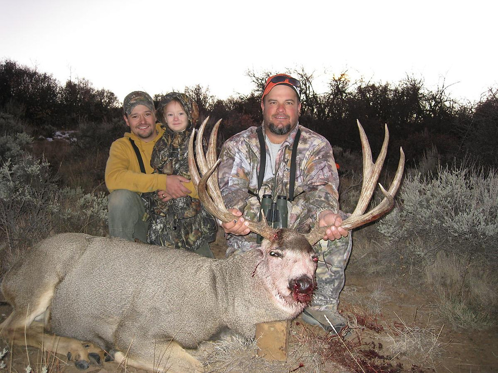 Mike and his nice trophy. Larissa was probably 4 in this picture.