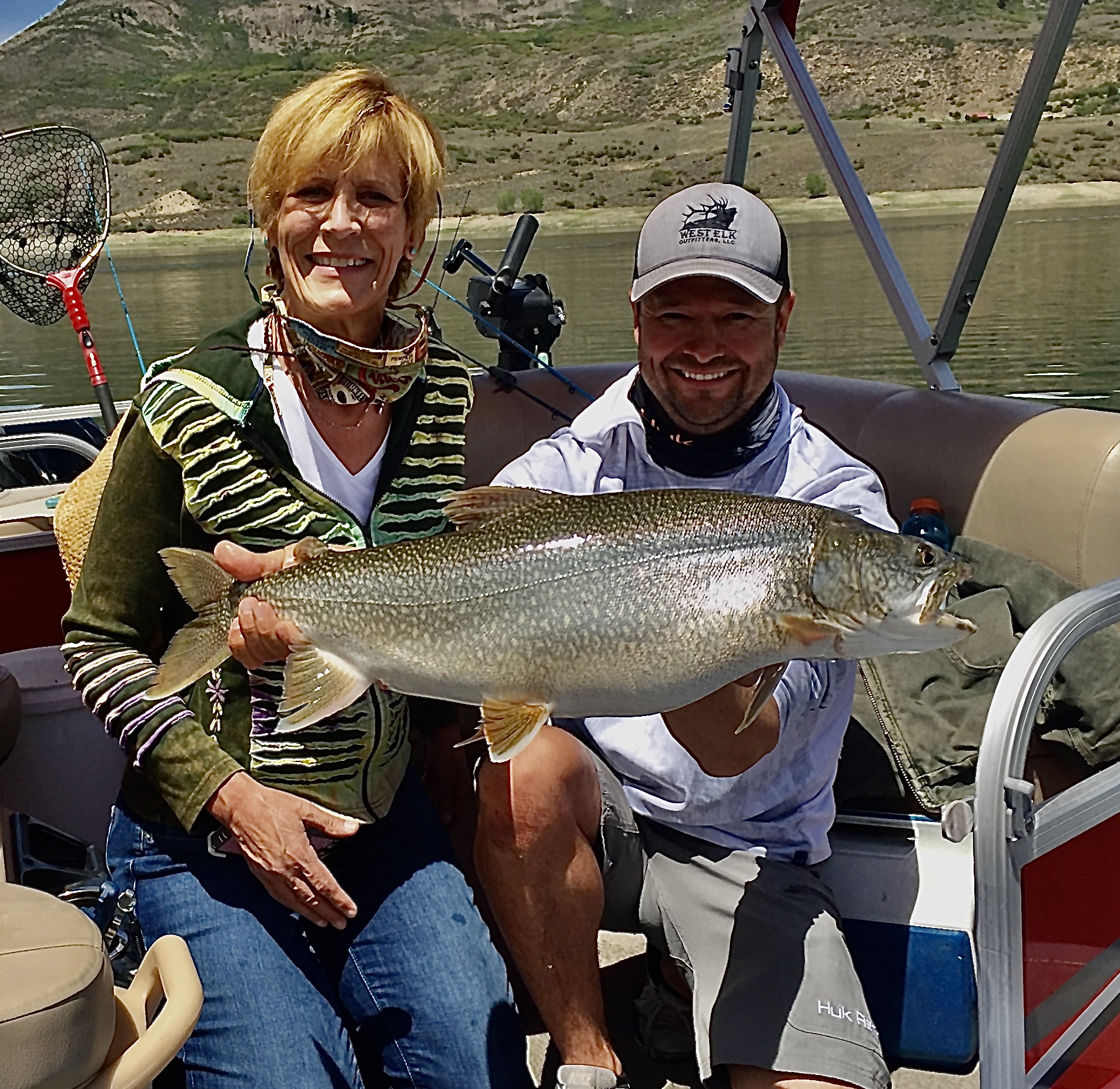 Happy Client with her trophy lake trout