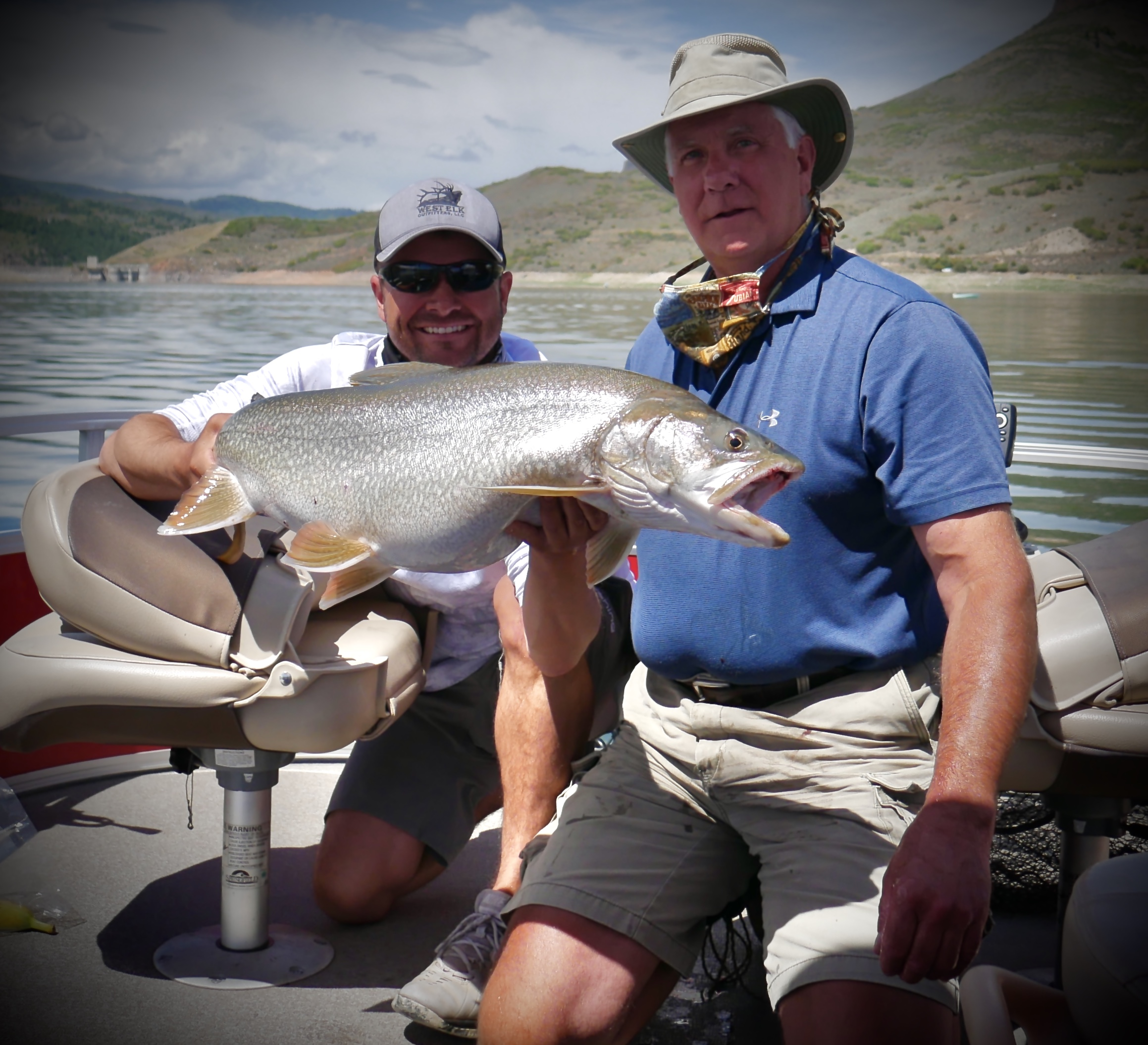Trophy Lake Trout = happy client