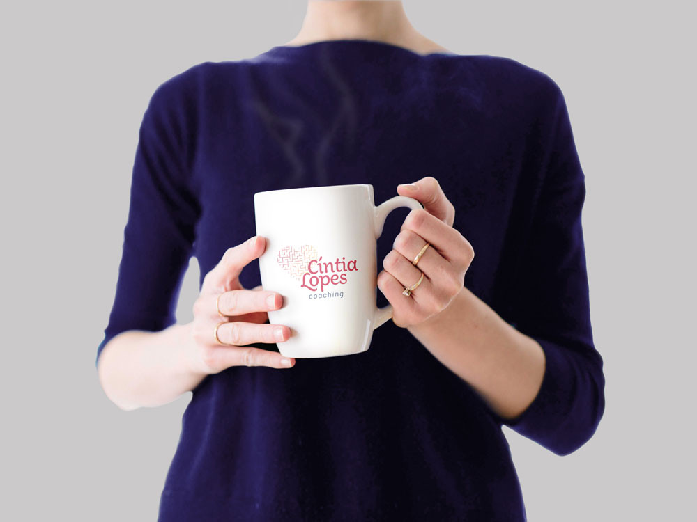 Woman-Holding-Coffee-Cup-MockupEDT.jpg