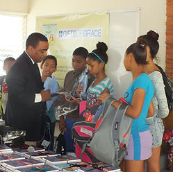 Dominican children receiving school supplies for the first time