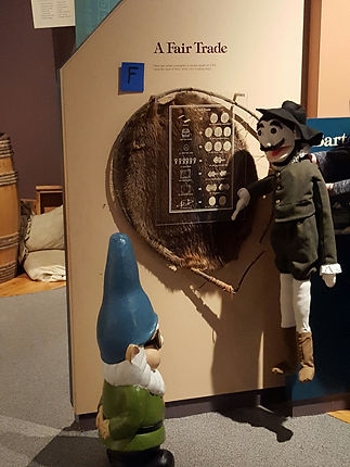 Capital District Tourism Gnome visits with Henry Hudson at the Albany, NY Visitor's Center