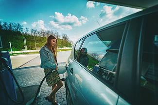 ey-woman-refilling-car-gas-pump.jpg