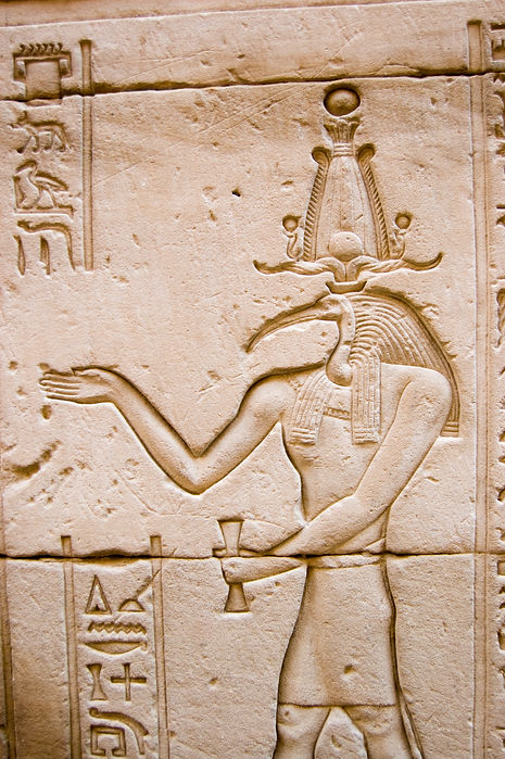 Ancient Egyptian hieroglyphic carving of the ibis headed god of knowledge Thoth.  Outer wa