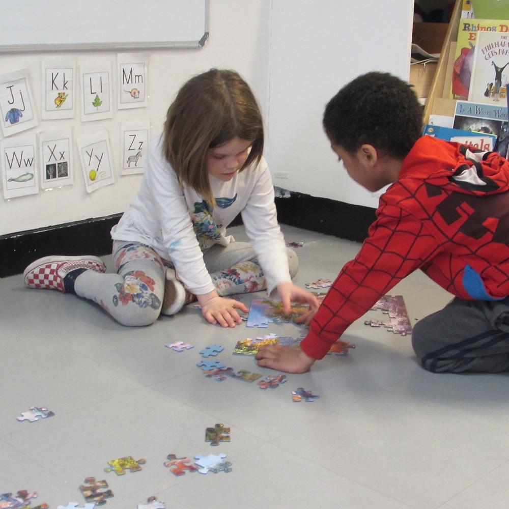Elena Fiorella-Baptista and Anthony Mafaro Jr., VsM,  collaborating on a puzzle