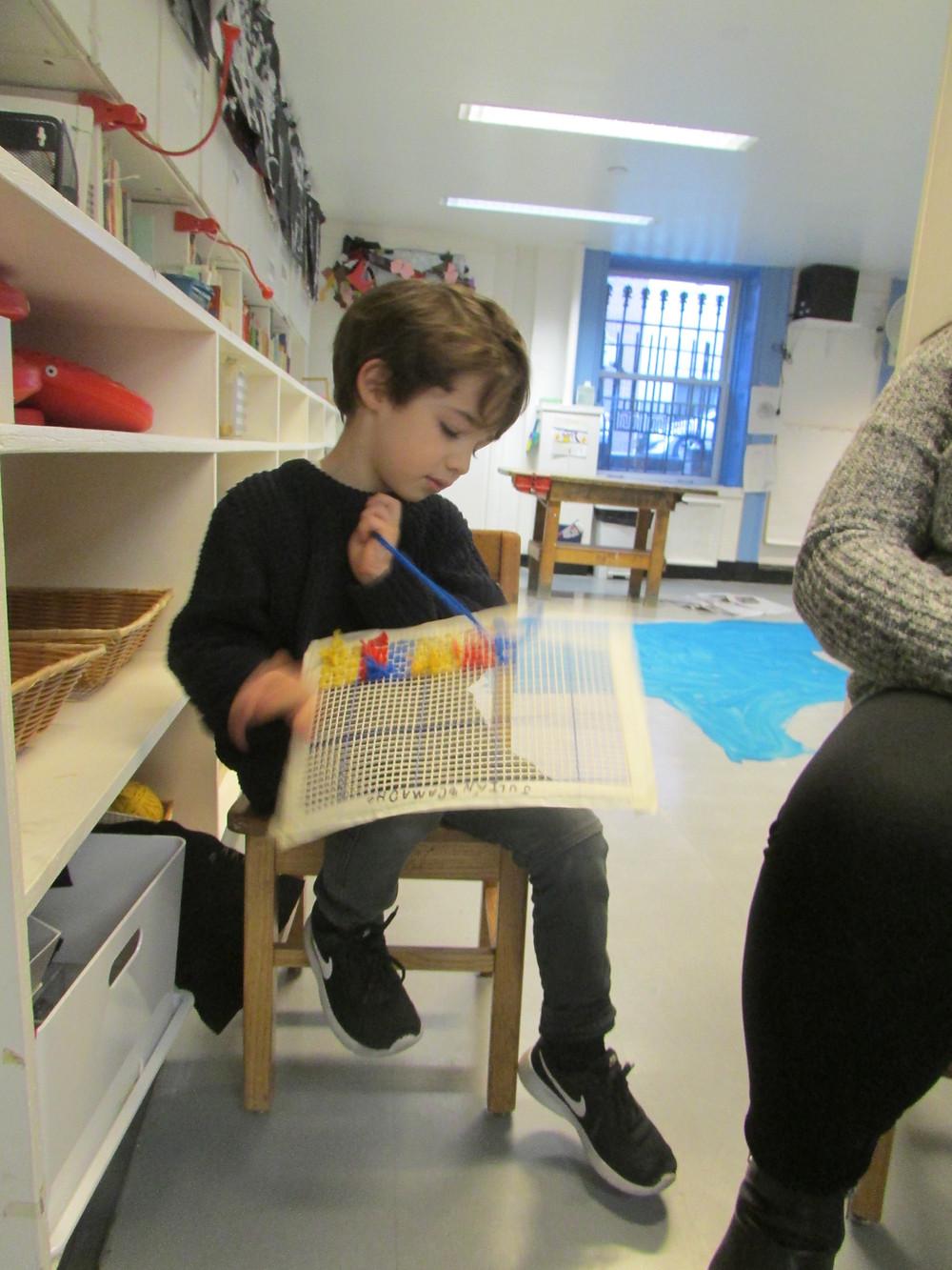 Julian Camacho sewing in class