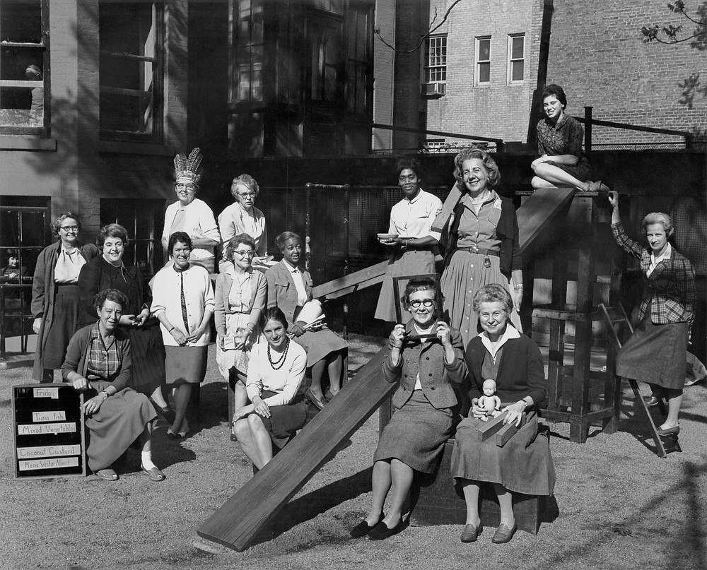 Teachers, including Sylvia Miller, Roni MacLeod, Jean Murray, and Virginia Parker gathered in the Block Yard (photo taken in 1963)